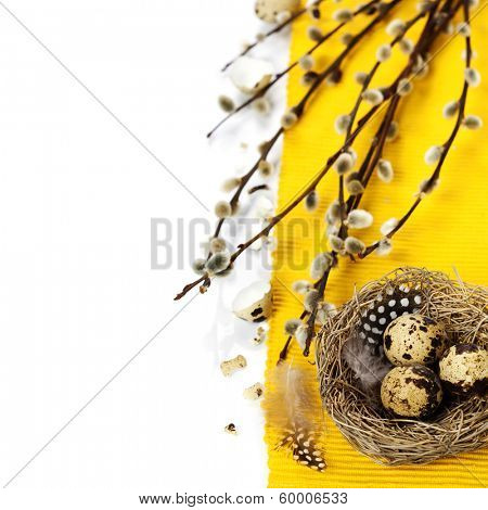 Easter still life of quail eggs and willow branches