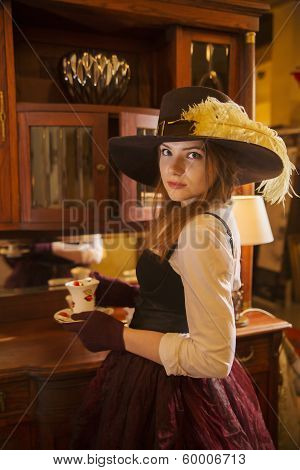 Woman At Fashioned Dress With Porcelain Cup