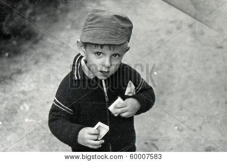 KURSK, USSR - CIRCA 1980s: An antique photo shows portrait of a little boy on the walk