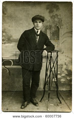 MOSCOW, USSR - CIRCA 1926: An antique photo shows studio portrait of a boy student.