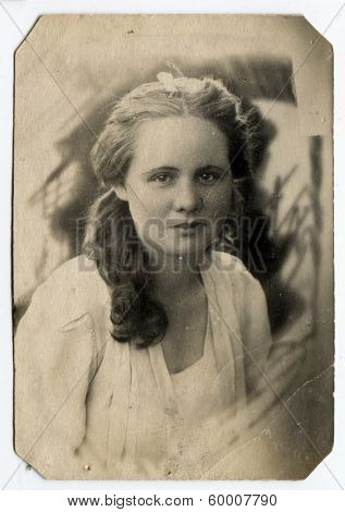 KURSK, USSR - CIRCA 1946: An antique photo shows studio portrait of a young woman.