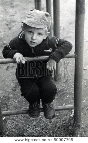 KURSK, USSR - CIRCA 1980: An antique photo shows portrait of a little boy on the walk