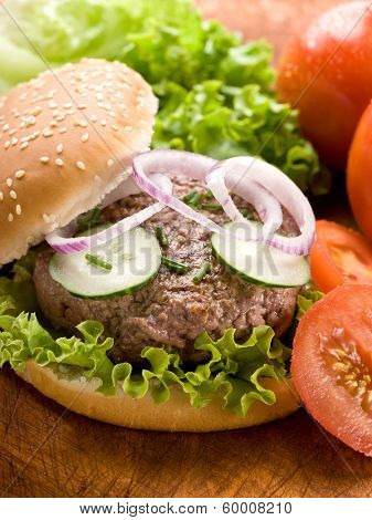 sandwich with hamburger and slice vegetables