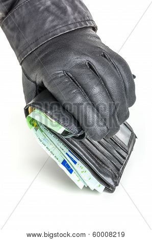 Thief with leather glove is reaching for a wallet