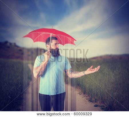 a guy in a thunderstorm under a red umbrella on a clear sunny da