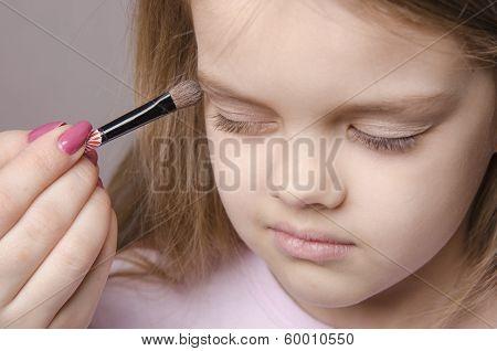 Makeup Artist Paints Eyelids On Girl's Face