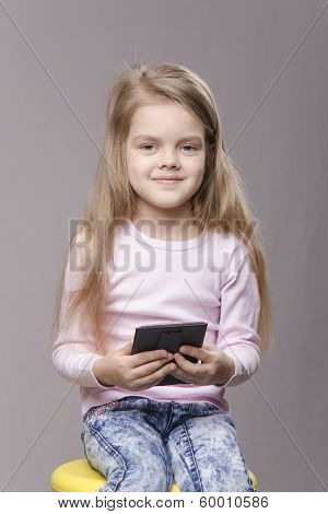 Portrait Girl With A Small Mirror In Hands Of