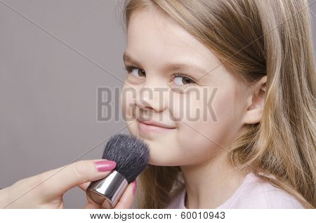 Makeup Artist Deals Powder On Face Of Girl
