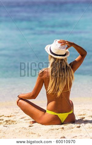 Beautiful Woman Enjoying The Sun In Front Of The Ocean