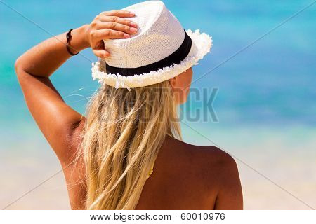 Beautiful Woman Wearing A Hat Looking At The Ocean
