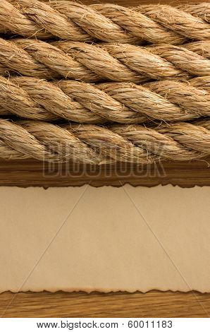 ropes and old paper at wooden background