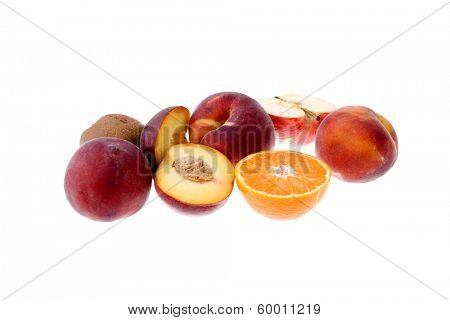 some peaches and a orange isolated on white background