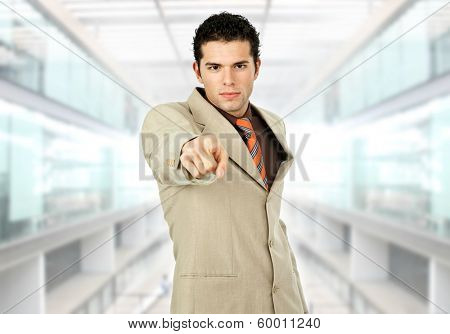young businessman pointing with his finger at the office