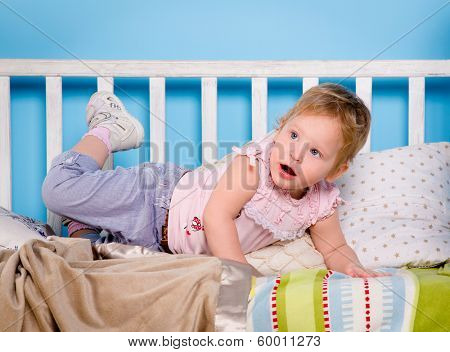 Baby playing on bed