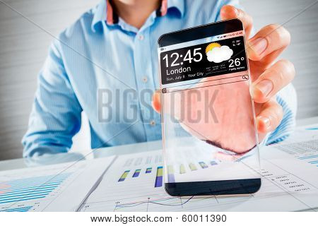 Futuristic Smart phone (copy space display) with a transparent display in human hands. Concept actual future innovative ideas and best technologies humanity.