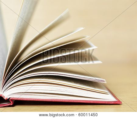 One book on wooden table with blurred effect