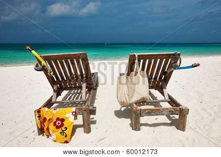Beautiful beach at Maldives with chaise-lounges