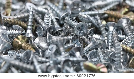 Zinked and anodized screws. Close up. Whole background. poster