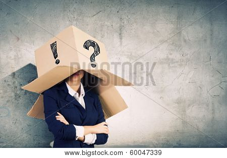 Businesswoman wearing carton box with marks on head