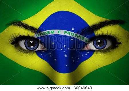 Woman with Brazil flag painted on her face poster
