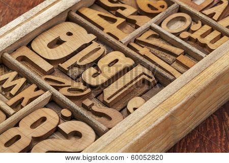 letterpress wood type blocks in a typesetter drawer