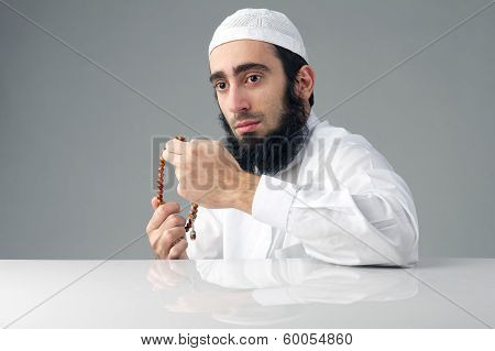 Arabian religious muslim man holding a rosemary