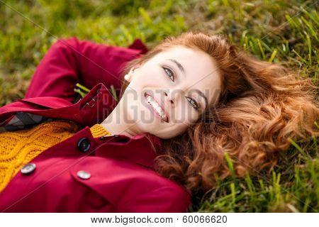Outdoor Portrait Of Beautiful Redhead Woman