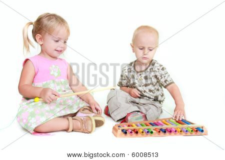 Two Children Playing Music Piano Over White