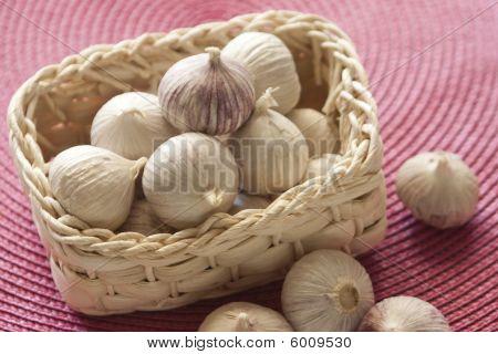 Bunch Of Garlic In A Basket