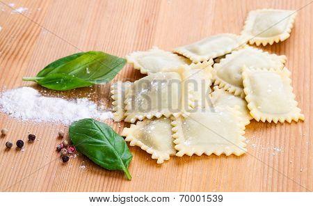 Homemade Pasta Ravioli With Fresh Basil, On Wooden Background