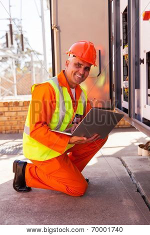 professional senior electrician working in substation