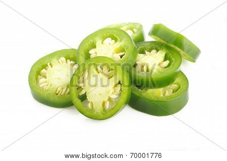 Sliced Green Jalapeno Peppers On White