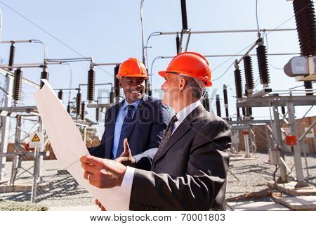 two businessmen working in power plant