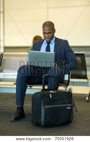 smart african businessman using tablet computer at airport