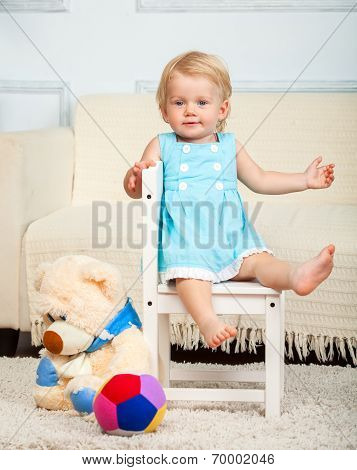 Little child is sitting on the chair