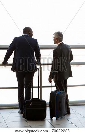 rear view of two businesspeople at airport
