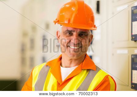 close up portrait of middle aged power company technical worker