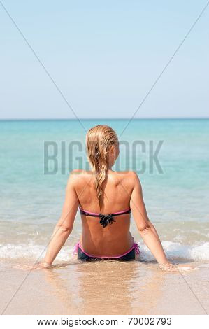 Young Woman In The Beach