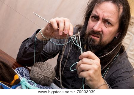 Man Is Trying To Knit