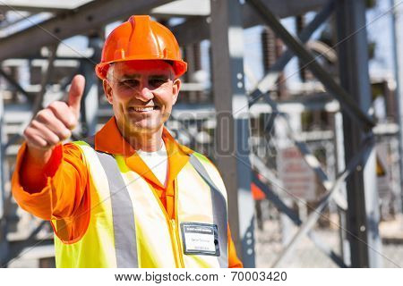 middle aged electrician giving thumb up in substation