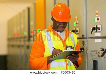 african electrical engineer in substation control room
