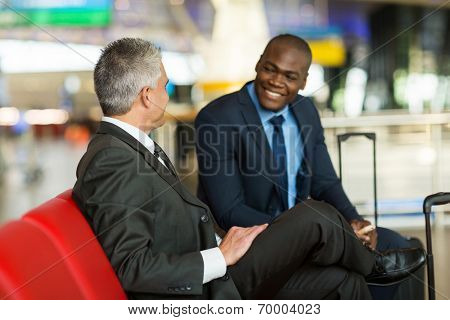happy business partners waiting at airport lounge