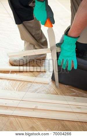Man With Handsaw
