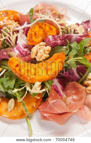 Hot salad with vegetables and nuts