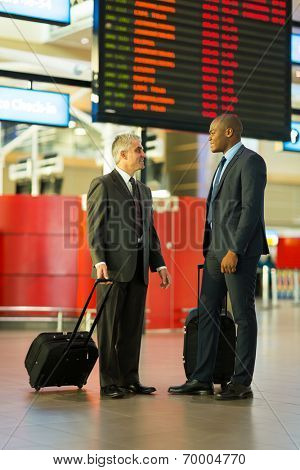 handsome businessmen in airport travelling together