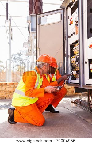 modern industrial engineers working in electric substation