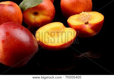 Several Sliced Nectarines Isolated On Black