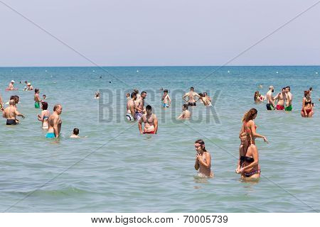 Very Crowded Beach Full Of People At Katerini Beach, In Greece. Katerini Is A Popular Destination Fa