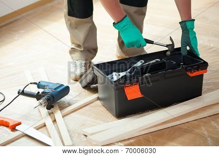 Man With Toolbox During Renovation