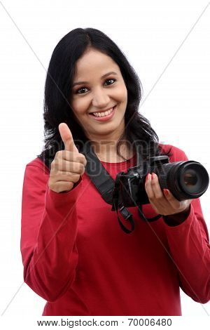 Young Woman Photographer Taking Images